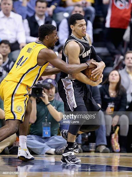 Danny Green of the San Antonio Spurs struggles to hold onto the ball while defended by Solomon Hill of the Indiana Pacers during the game at Bankers...