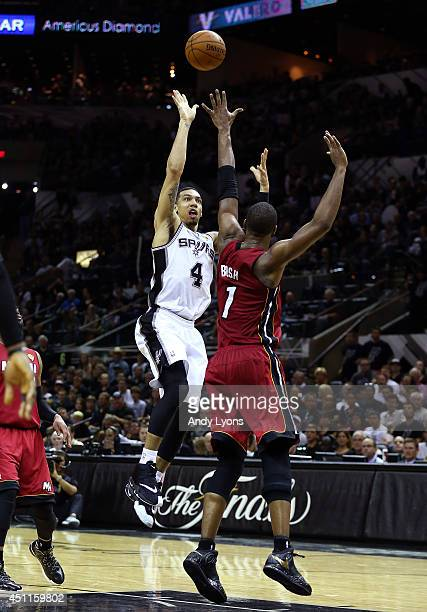 Danny Green of the San Antonio Spurs takes a shot over Chris Bosh of the Miami Heat during Game One of the 2014 NBA Finals at the ATT Center on June...
