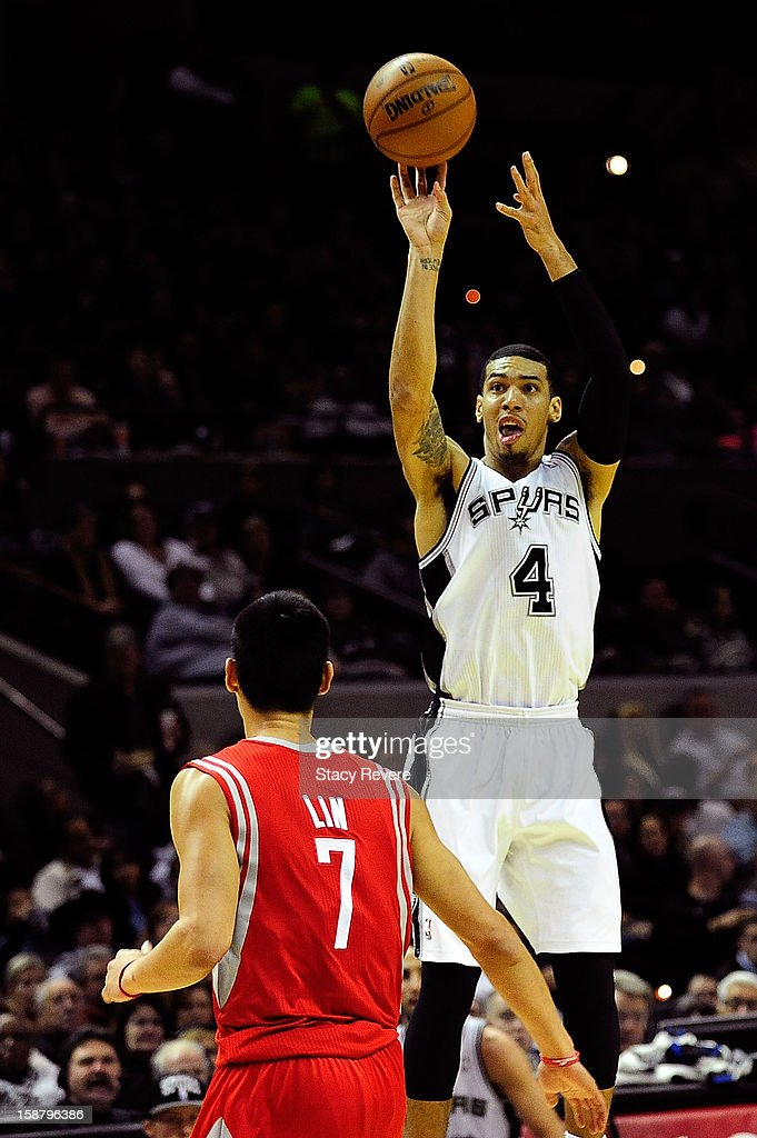 Danny Green #4 of the San Antonio Spurs takes a shot over Jeremy Lin #7 of the Houston Rockets during a game at AT&T Center on December 28, 2012 in San Antonio, Texas. San Antonio won the game 122-116.