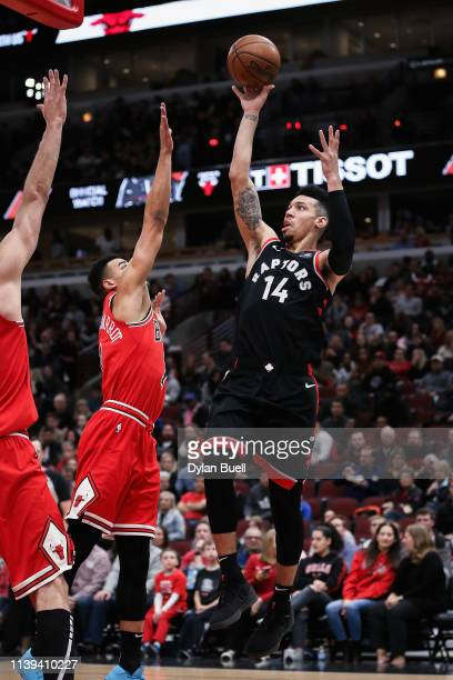 Danny Green of the Toronto Raptors attempts a shot while being guarded by Timothe LuwawuCabarrot of the Chicago Bulls in the first quarter at the...