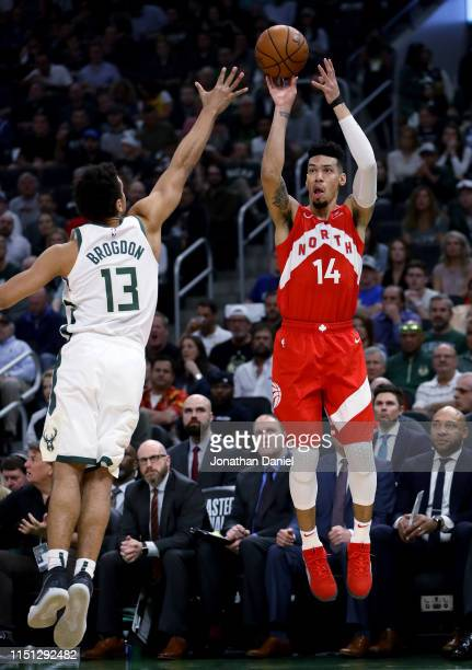 Danny Green of the Toronto Raptors attempts a shot while being guarded by Malcolm Brogdon of the Milwaukee Bucks in the first quarter during Game...