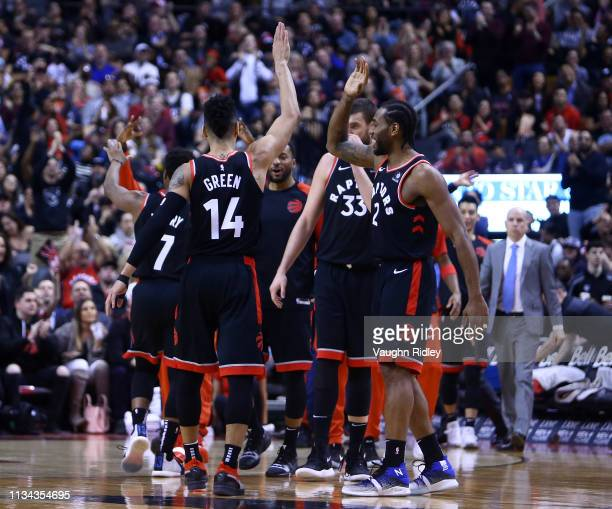 Danny Green of the Toronto Raptors celebrates a 3pointer with teammates during the second half of an NBA game against the Orlando Magic at Scotiabank...