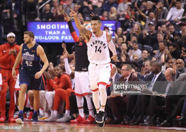 Danny Green of the Toronto Raptors celebrates after making a threepointer against the Dallas Mavericks at Scotiabank Arena on October 26 2018 in...