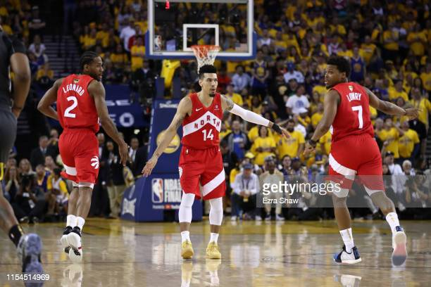 Danny Green of the Toronto Raptors celebrates the basket with Kawhi Leonard and Kyle Lowry against the Golden State Warriors in the second half...