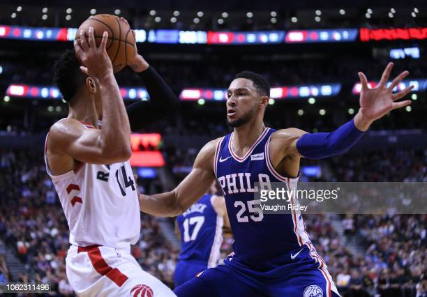 Danny Green of the Toronto Raptors dribbles the ball as Ben Simmons of the Philadelphia 76ers defends during the second half of an NBA game at...