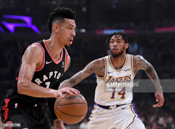 Danny Green of the Toronto Raptors dribbles the ball in front of Brandon Ingram of the Los Angeles Lakers at Staples Center on November 4 2018 in Los...