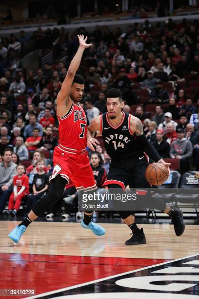 Danny Green of the Toronto Raptors dribbles the ball while being guarded by Timothe LuwawuCabarrot of the Chicago Bulls in the first quarter at the...