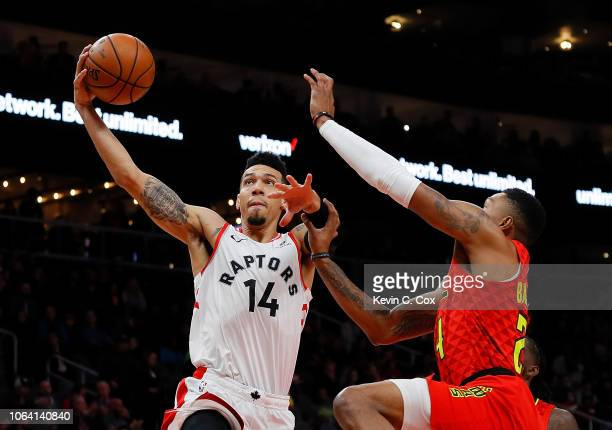 Danny Green of the Toronto Raptors drives against Kent Bazemore of the Atlanta Hawks at State Farm Arena on November 21 2018 in Atlanta Georgia NOTE...