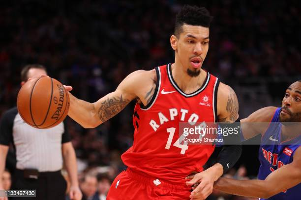 Danny Green of the Toronto Raptors drives around Wayne Ellington of the Detroit Pistons during the first half at Little Caesars Arena on March 03...