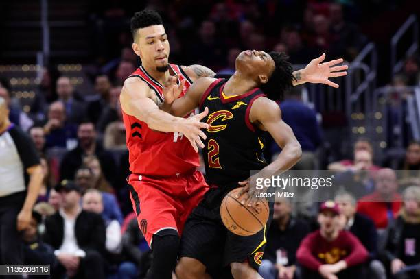 Danny Green of the Toronto Raptors guards Collin Sexton of the Cleveland Cavaliers during the first half at Quicken Loans Arena on March 11 2019 in...