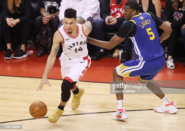 Danny Green of the Toronto Raptors is defended by Kevon Looney of the Golden State Warriors in the first half during Game Five of the 2019 NBA Finals...