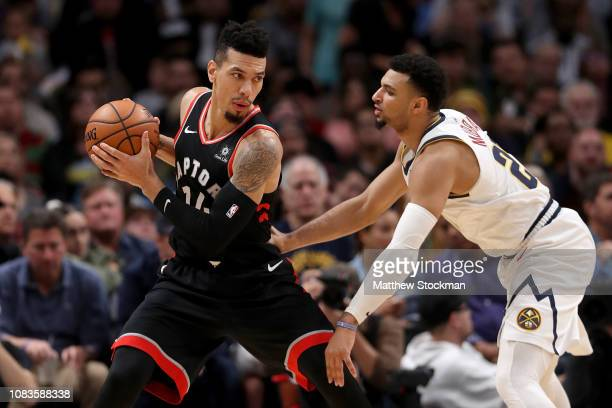 Danny Green of the Toronto Raptors is guarded by Jamal Murray of the Denver Nuggets at the Pepsi Center on December 16 2018 in Denver Colorado