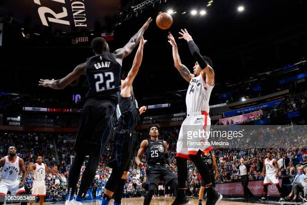 Danny Green of the Toronto Raptors makes the game winning the shot against the Orlando Magic winning the game 9391 on November 20 2018 at Amway...