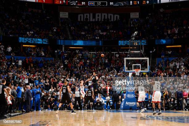 Danny Green of the Toronto Raptors shoots the game winning shot against the Orlando Magic winning the game 9391 on November 20 2018 at Amway Center...