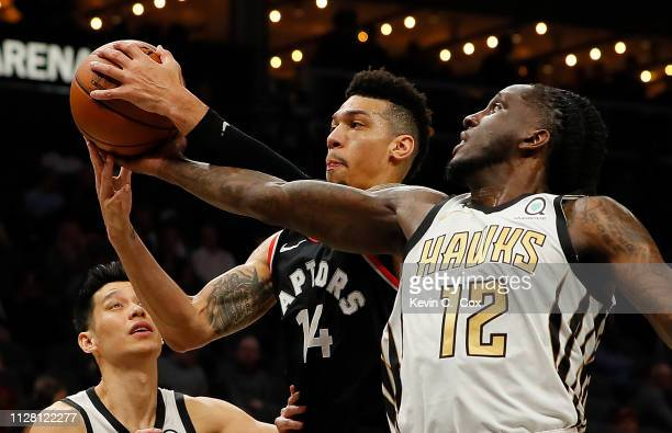 Danny Green of the Toronto Raptors steals a rebound from Taurean Prince of the Atlanta Hawks in the first half at State Farm Arena on February 07...