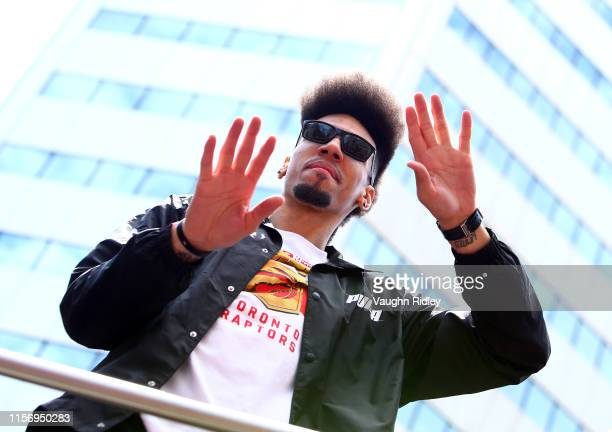 Danny Green of the Toronto Raptors waves from his bus during the Toronto Raptors Victory Parade on June 17 2019 in Toronto Canada The Toronto Raptors...