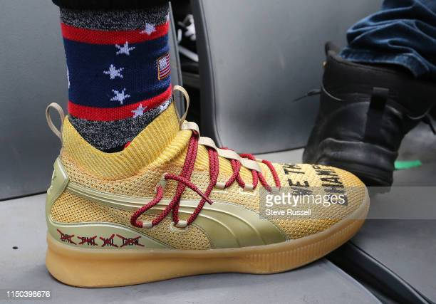 TORONTO ON JUNE 17 Danny Green sports new shoes as the Toronto Raptors hold their victory parade after beating the Golden State Warriors in the NBA...