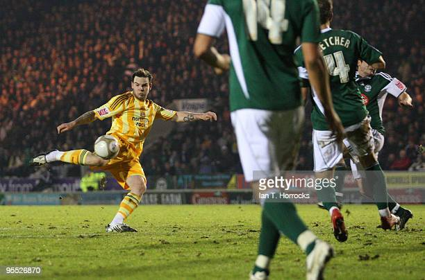 Danny Guthrie of Newcastle shoots at goal during the third round match of The FA Cup, sponsored by E.ON, between Plymouth Argyle and Newcastle United...