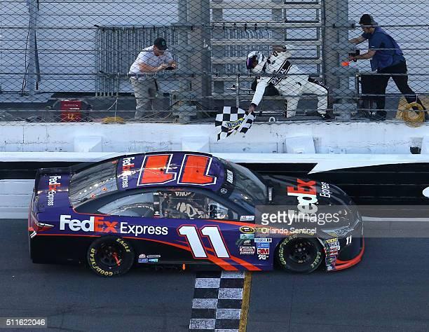 Danny Hamlin picks up the checkered flag after winning the Daytona 500 at Daytona International Speedway in Daytona Beach Fla on Sunday Feb 21 2016