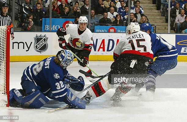 Danny Heatley of the Ottawa Senators slides the puck past goalie Mikael Tellqvist of the Toronto Maple Leafs for his fourth goal of the game at the...