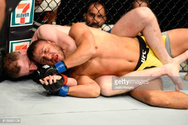 Danny Henry of Scotland attempts to submit Daniel Teymur of Sweden in their lightweight bout during the UFC Fight Night event at the SSE Hydro Arena...
