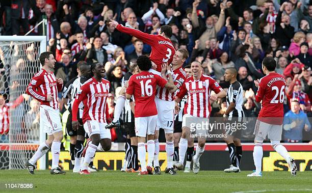 Danny Higginbotham is held aloft by team mates after scoring his team's third goal during the Barclays Premier League match between Stoke City and...