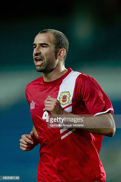 Danny Higginbotham of Gibraltar gives instructions to his teammates during the international friendly match between Gibraltar and Slovakia at Estadio...
