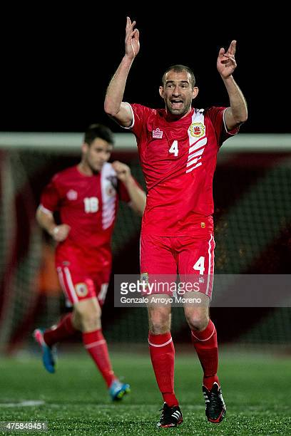 Danny Higginbotham of Gibraltar gives instructions to his teammates during the International Friendly football match between Gibraltar and Faroe...