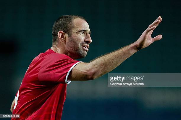 Danny Higginbotham of Gibraltar gives instructions to their teammates during the international friendly match between Gibraltar and Slovakia at...
