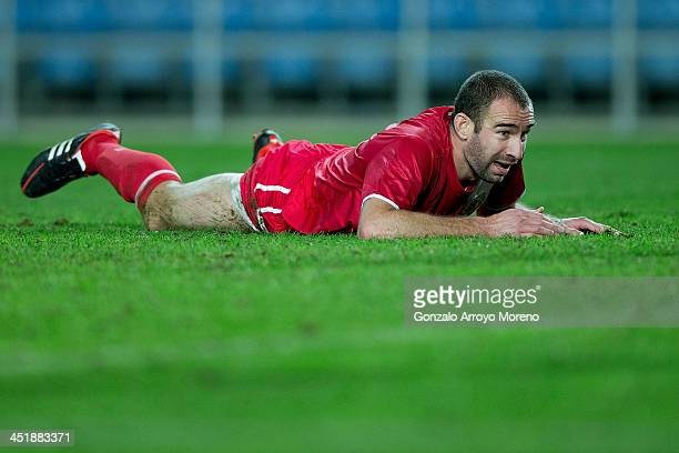 Danny Higginbotham of Gibraltar lies on the ground after being tackled during the international friendly match between Gibraltar and Slovakia at...