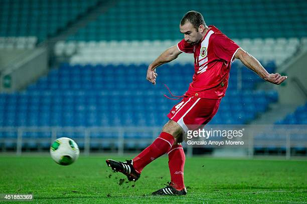 Danny Higginbotham of Gibraltar strikes the ball during the international friendly match between Gibraltar and Slovakia at Estadio do Alagarve on...