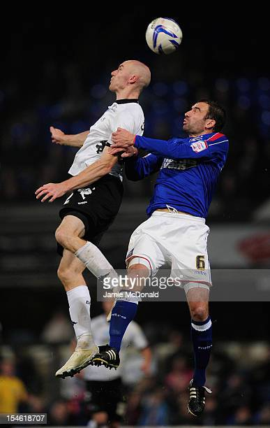 Danny Higginbotham of Ipswich Town jumps with Connor Sammon of Derby County during the npower Championship match between Derby County and Ipswich...