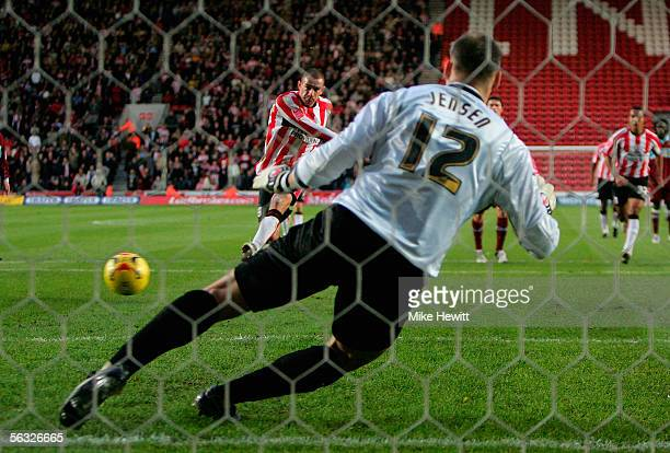 Danny Higginbotham of Southampton sends Brian Jensen of Burnley the wrong way from the penalty spot during the CocaCola Championship match between...