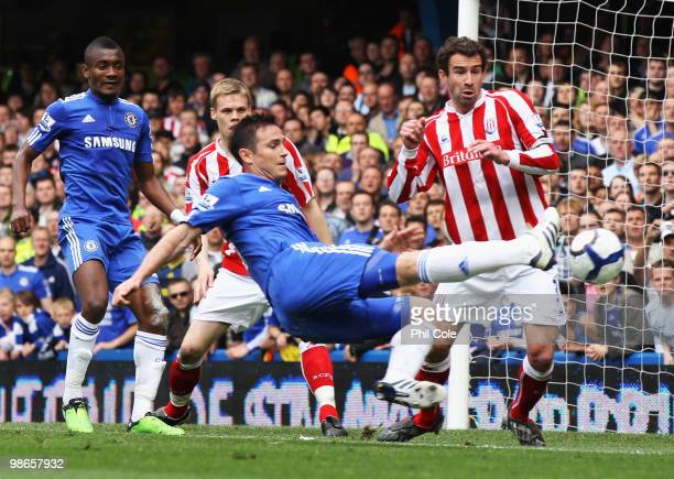 Danny Higginbotham of Stoke City attempts to block Frank Lampard of Chelsea as he shoots for goal during the Barclays Premier League match between...