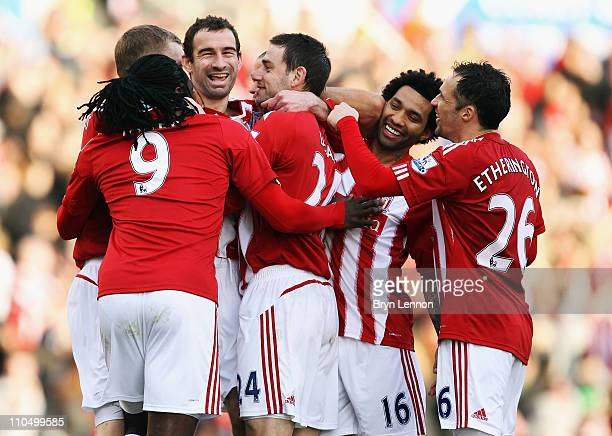 Danny Higginbotham of Stoke City celebrates with his team after scoring during the Barclays Premier League match between Stoke City and Newcastle...