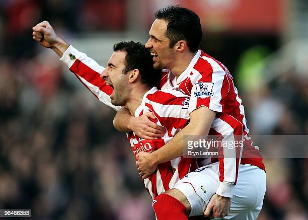 Danny Higginbotham of Stoke City celebrates with team mate Mathew Etherington after scoring during the Barclays Premier League match between Stoke...