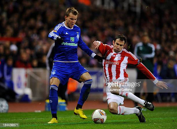 Danny Higginbotham of Stoke City challenges Andrii Iarmolenko of Dynamo Kyiv during the UEFA Europa League Group E match between Stoke City and FC...