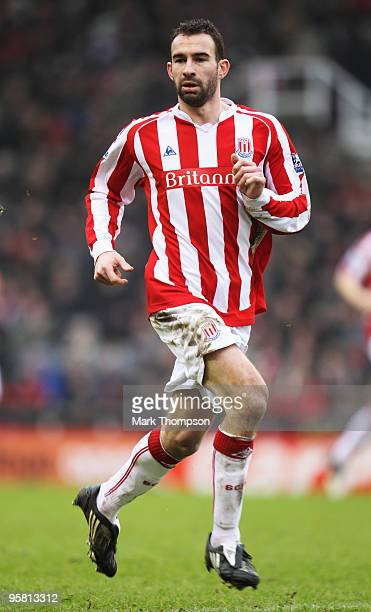 Danny Higginbotham of Stoke City in action during the Barclays Premier League match between Stoke City and Liverpool at the Britannia Stadium on...