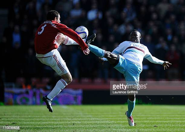 Danny Higginbotham of Stoke City is challenged by Victor Obinna of West Ham United during the FA Cup sponsored by EON 6th Round match between Stoke...