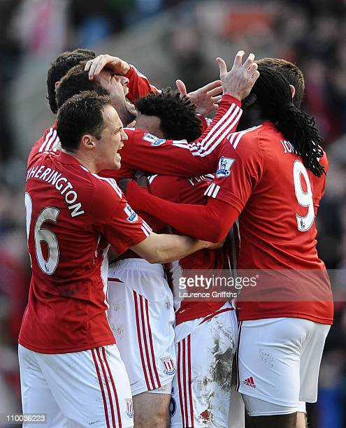 Danny Higginbotham of Stoke City is mobbed by team mates after scoring his goal during the FA Cup sponsored by EON 6th Round match between Stoke City...