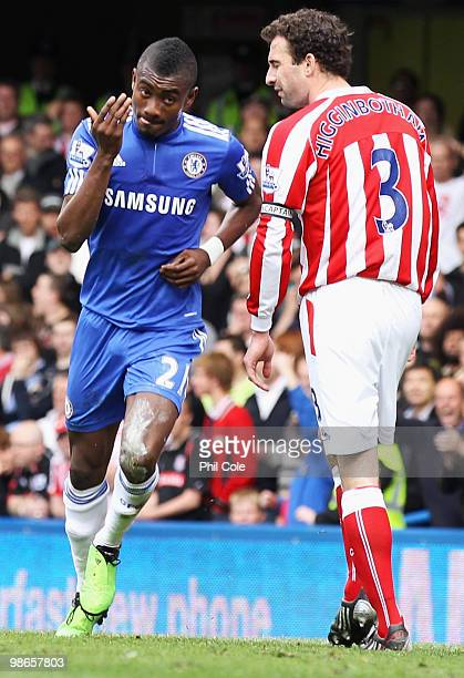 Danny Higginbotham of Stoke City looks dejected as Salomon Kalou of Chelsea celebrates scoring their first goal during the Barclays Premier League...