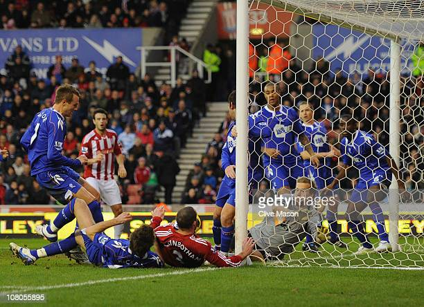 Danny Higginbotham of Stoke City scores during the Barclays Premier League match between Stoke City and Bolton Wanderers at Britannia Stadium on...