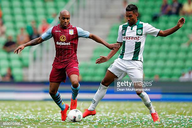 Danny Hoesen of Groningen and Fabian Delph of Aston Villa battle for the ball during the pre season friendly match between FC Groningen v Aston Villa...
