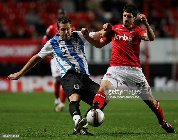 Danny Hollands of Charlton and Jon Parkin of Huddersfield battle for the ball during the npower League One match between Charlton Athletic and...