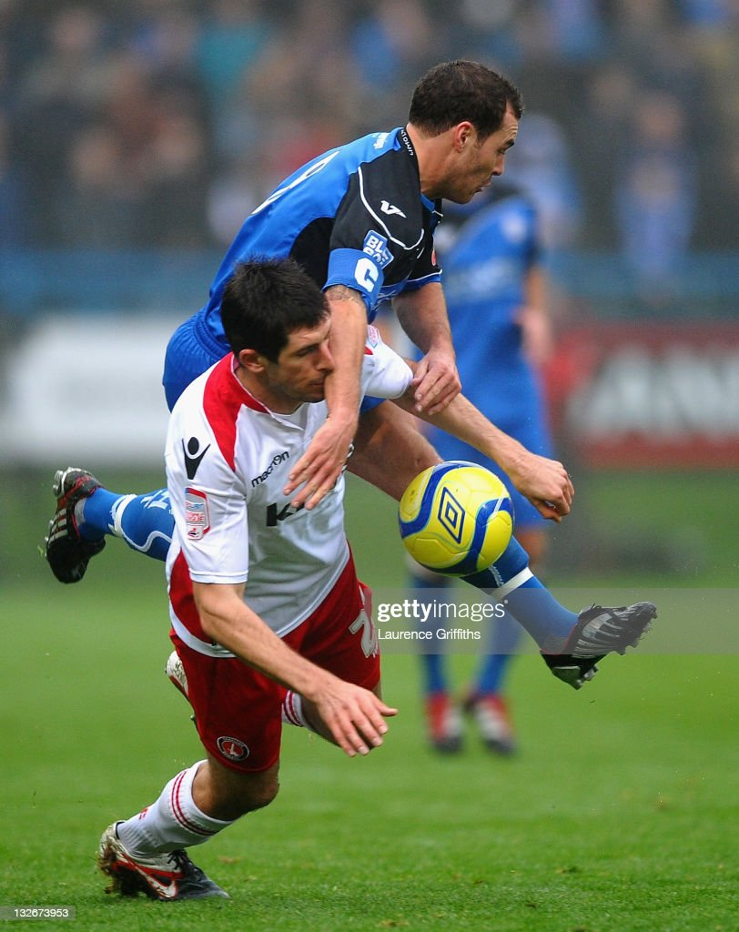Danny Hollands of Charlton battles with Tom Baker of Halifax Town during the FA Cup sponsored by Budweiser First Round match between Halifax Town and Charlton Athletic at the Shay on November 13, 2011 in Halifax, England.