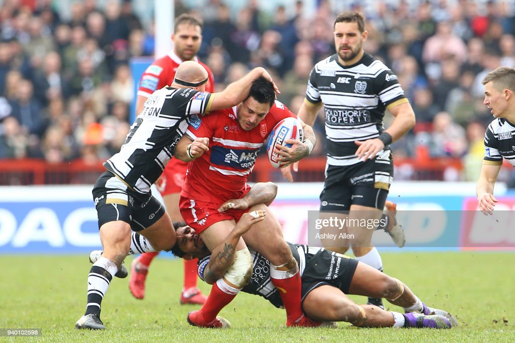 Danny Houghton (L) and Albert Kelly (R) of Hull FC tackle Justin Carney (C) of Hull KR during the BetFred Super League match between Hull KR and Hull FC at KCOM Craven Park on March 30, 2018 in Hull, England.