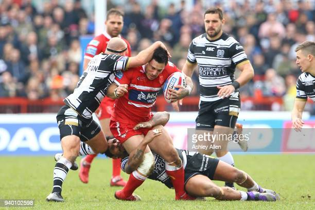Danny Houghton and Albert Kelly of Hull FC tackle Justin Carney of Hull KR during the BetFred Super League match between Hull KR and Hull FC at KCOM...