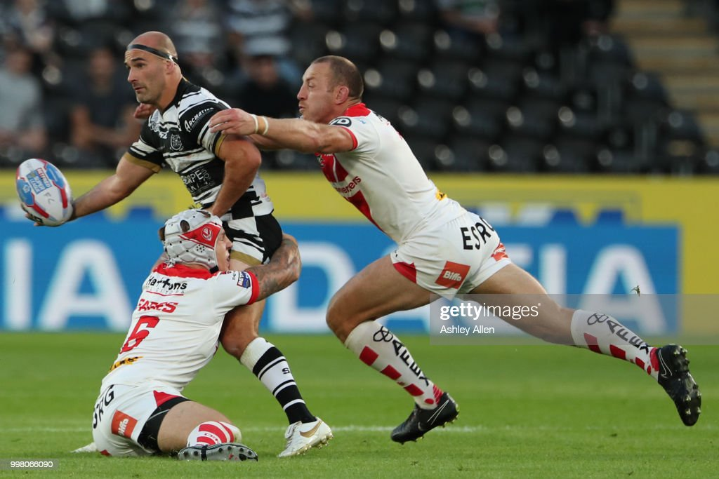 Danny Houghton of Hull FC is tackled by James Roby and Theo Fages of St Helens during the BetFred Super League match between Hull FC and St Helens Saints at the KCOM Stadium on July 13, 2018 in Hull, England.