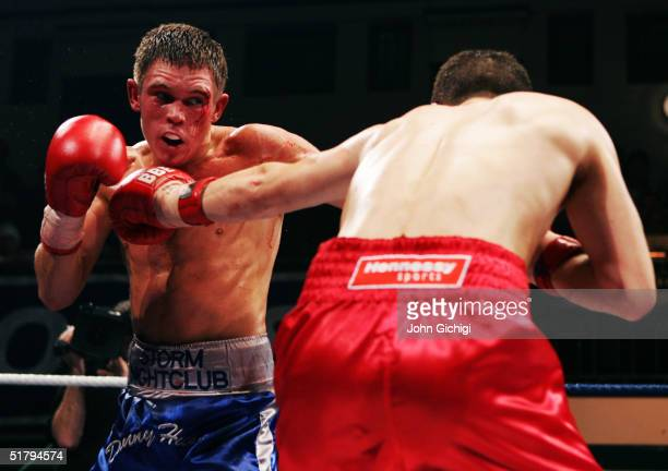Danny Hunt of England in action against Lee Meager of England during their English Lightweight Title fight at York Hall on November 19 2004 in...