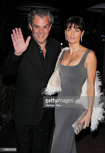 Danny Huston and Lyne Renee arrive at a pre-Oscar dinner with Charles Finch hosted by Chanel held at Madeo Restaurant on February 26, 2011 in Los...